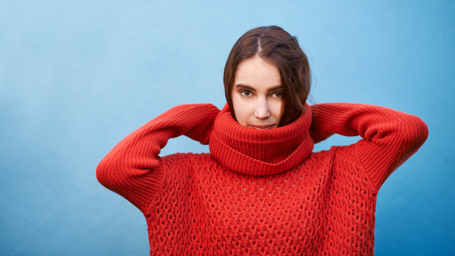 girl in oversized red sweater