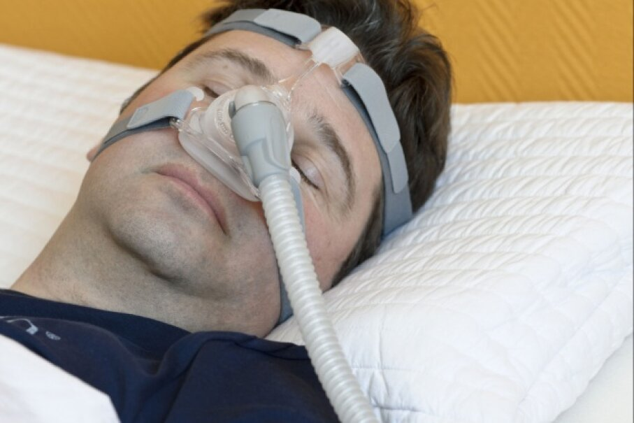Advanced cases of sleep apnea may require the use of a CPAP machine. While there are often multiple contributors to the development of sleep apnea, getting regular exercise may help stave off the problem. © graustufe/iStock/Thinkstock