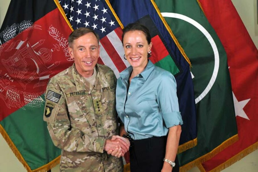 CIA director Gen. Davis Petraeus poses with his biographer Paula Broadwell, with whom  he had an extra-marital affair that was discovered through an e-mail trail. See more historical couples pictures. ISAF via Getty Images