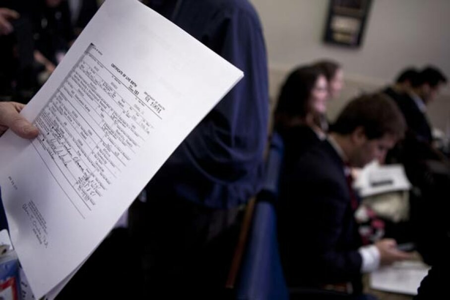 A reporter holds a copy of President Barack Obama's long form birth certificate in the briefing room of the White House in 2011.  Obama released this after extended criticism by those who do not believe he was born in the United States Brendan Smialowski/Getty Images