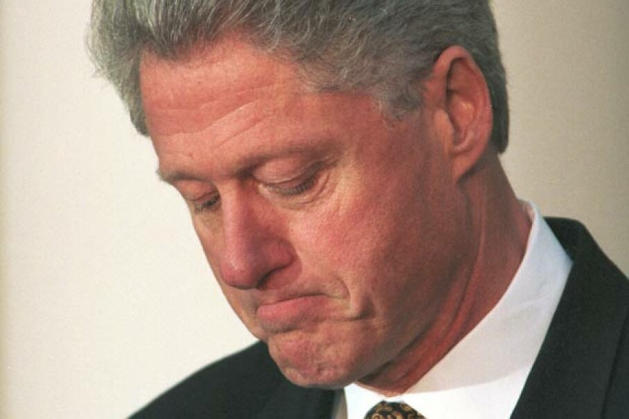 President Bill Clinton pauses as he apologizes to the U.S. on Dec. 11, 1998 for his conduct in the Monica Lewinsky affair. Rex Banner/Getty Images