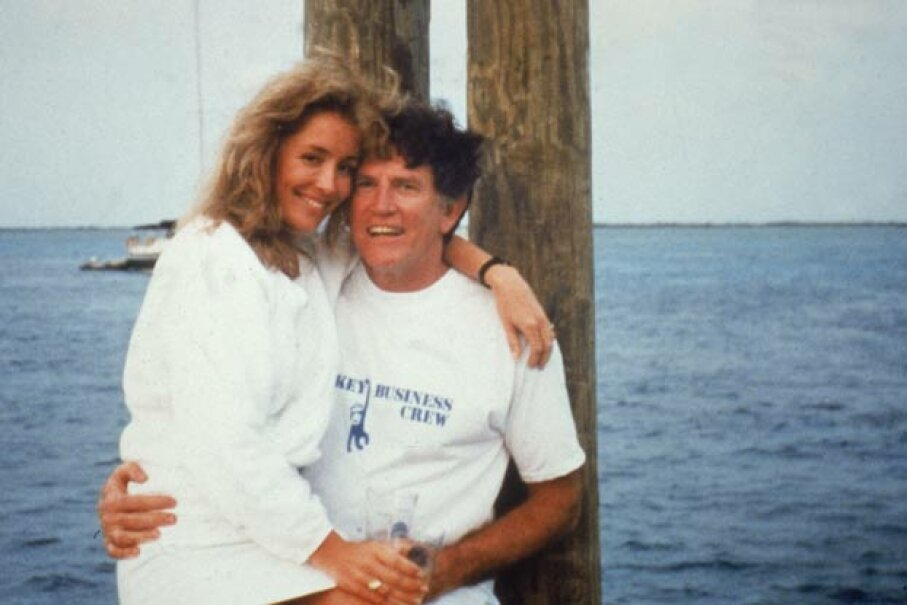 "The famous photo of Gary Hart wearing an unfortunately named ""Monkey Business"" T-shirt (the name of his boat) with mistress Donna Rice on his lap. National Enquirer/Getty Images"