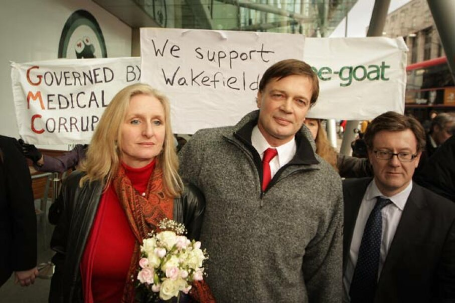 Surrounded by supporters, Dr. Andrew Wakefield (C) walks with his wife Carmel after speaking to reporters at the British General Medical Council in Jan. 2010. His medical license was revoked by that body later in the year. Peter Macdiarmid/Getty Images