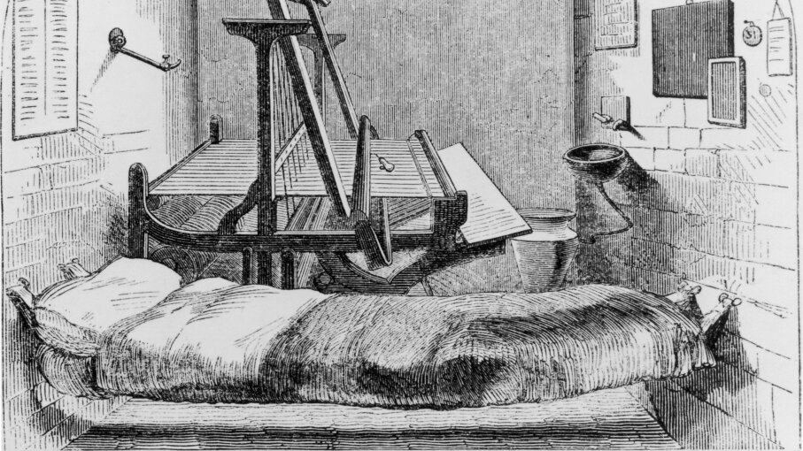 An early example of solitary confinement: a single cell, furnished with a suspended bed and a loom for day work, in Pentonville Prison, London, 1850. Hulton Archive/Getty Images