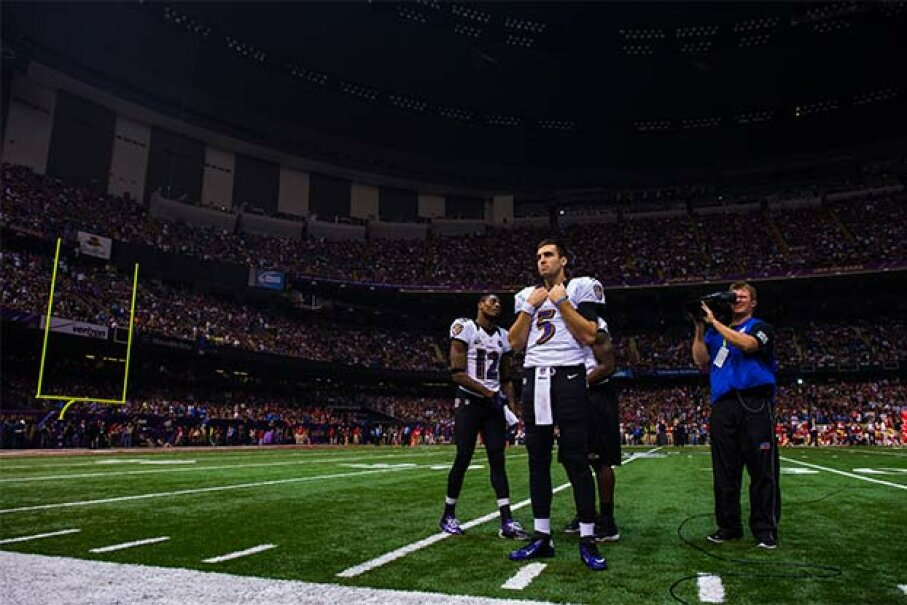 Joe Flacco, No. 5 of the Baltimore Ravens, looks on during the power outage in the third quarter of Super Bowl XLVII against the San Francisco 49ers in New Orleans in 2013. Some Ravens players think the blackout happened on purpose. Rob Tringali/SportsChrome/Getty Images