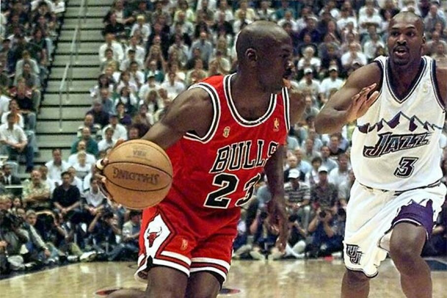 Michael Jordan didn't play like a man with stomach flu in Game 5 of the 1997 NBA finals. He scored 38 points and helped his team to a narrow victory over the Utah Jazz. JEFF HAYNES/AFP/Getty Images