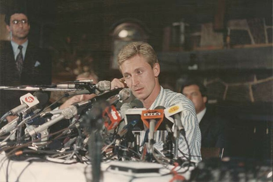 A visibly distraught Wayne Gretzky sits at the press conference where his trade from the Edmonton Oilers to the Los Angeles Kings is announced in 1988. Bruce Bennett Studios/Getty Images