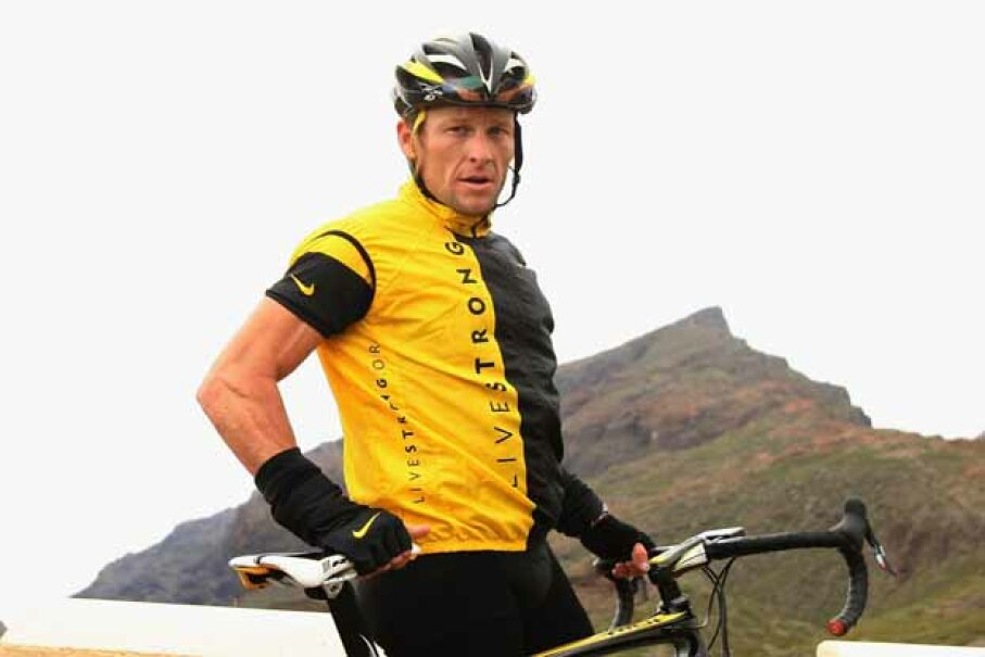 Lance Armstrong takes a stop during a training ride back in 2008. Will he continue wearing the Livestrong shirt now that he's off the board of the foundation that he created? Bryn Lennon/Getty Images