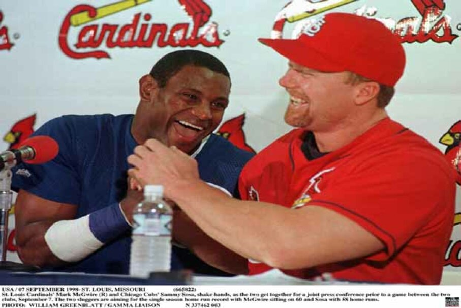 St. Louis Cardinal Mark McGwire (right) and Chicago Cub Sammy Sosa shown in happier times during a 1998 press conference prior to a game between the two clubs when they were duking it out for the home run record. Bill Greenblatt/Getty Images