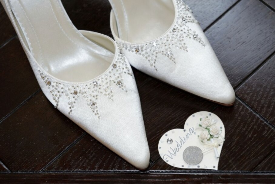 A coin in the bride's shoe may be intended to bring good fortune, but it may also lead to a sore foot. ©iStockphoto/Thinkstock