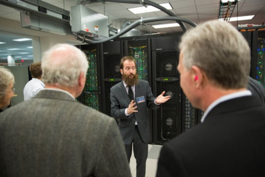 The director of the Texas Advanced Computing Center, Bill Barth, takes guests on a tour of Stampede. © TACC 2013