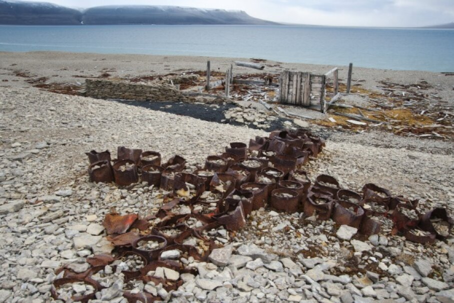 This memorial cross of empty tin cans, used as a post office to leave messages, dates to 1854 and the search for survivors of the ill-fated Sir John Franklin Expedition. It's located on Beechey Island in Nunavut, Canada. © Pat and Rosemarie Keough/Corbis