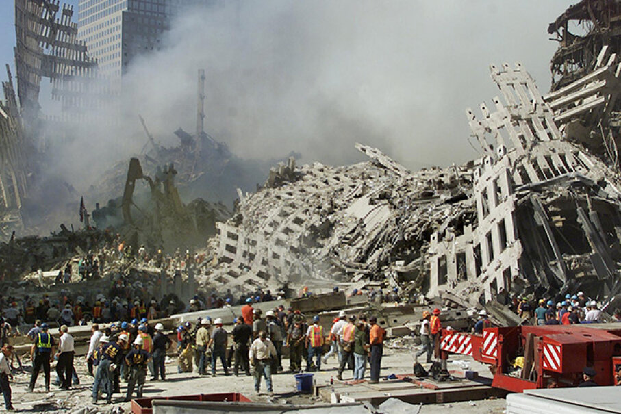 Rescue workers search for survivors as smoke rises from the rubble of the World Trade Center in New York, 2001. Genelle Guzman-McMillan was the last person pulled out alive. BETH A. KEISER/AFP/Getty Images
