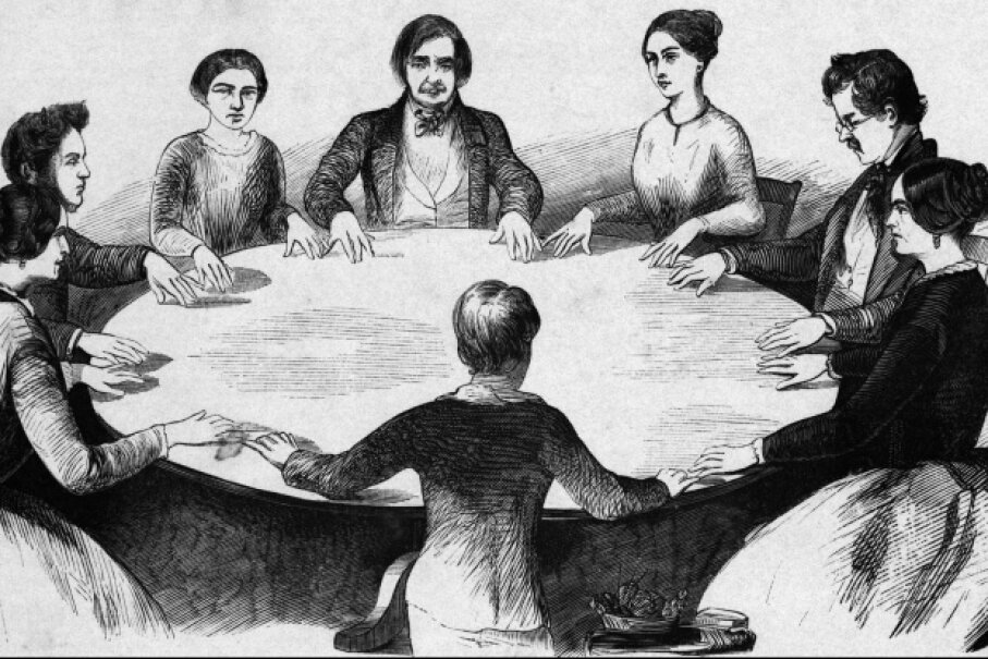 A woodcut of table rapping as practiced in the first half of the 19th century under the influence of the Fox sisters. © Bettmann/Corbis