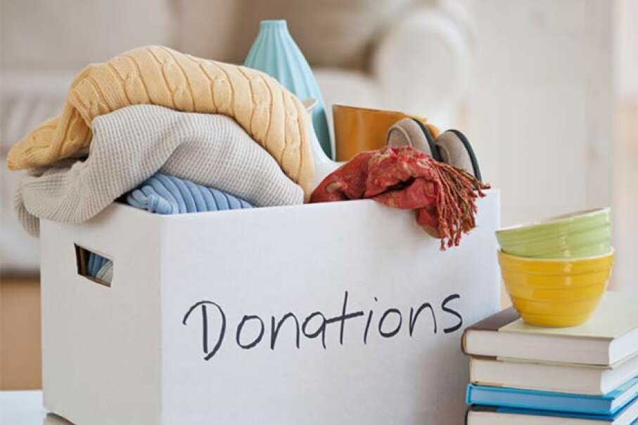 Many people deduct clothing donations on their taxes; they need to be wary of not overestimating their value to lessen their chances of an audit. Tetra Images/Getty Images
