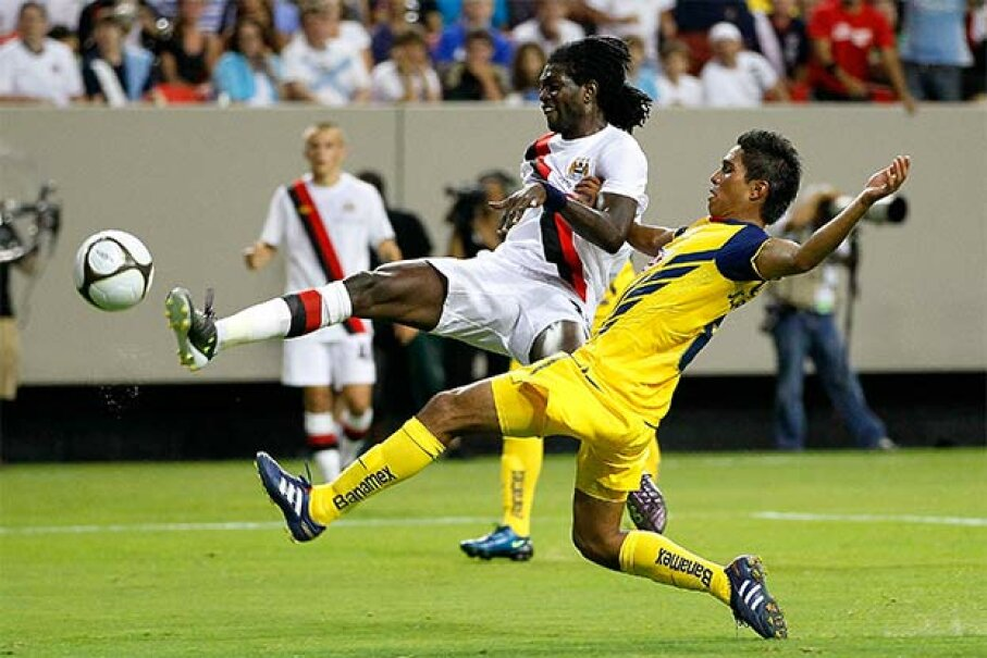 Emmanuel Adebayor (white shirt) of Manchester City takes a shot on goal against Pablo Zabaleta of Club America (Mexico) at a soccer match in Atlanta. Neither player would be subject to U.S. tax for any money earned during their tour of the country. Kevin C. Cox/Getty Images
