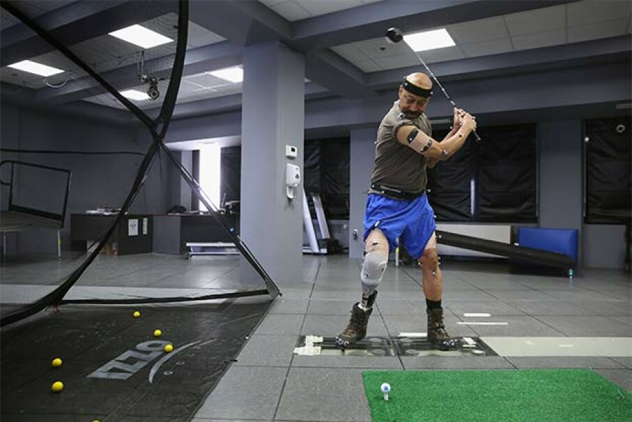 U.S. military veteran and amputee Lloyd Epps swings a driver while at the gait and motion analysis lab at the VA hospital in New York City. Epps lost his leg to an infection and wears a high-tech custom prosthetic. John Moore/Getty Images