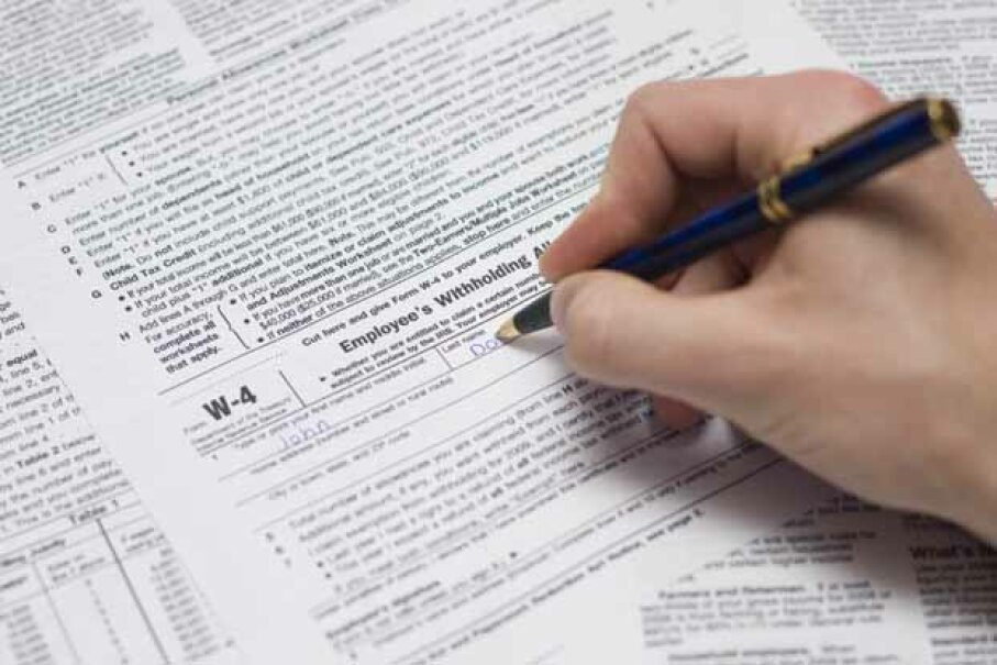 Lowering your number of exemptions on your W-4 is one way to get a bigger tax refund. Jeroen Geeraert/iStock/Thinkstock