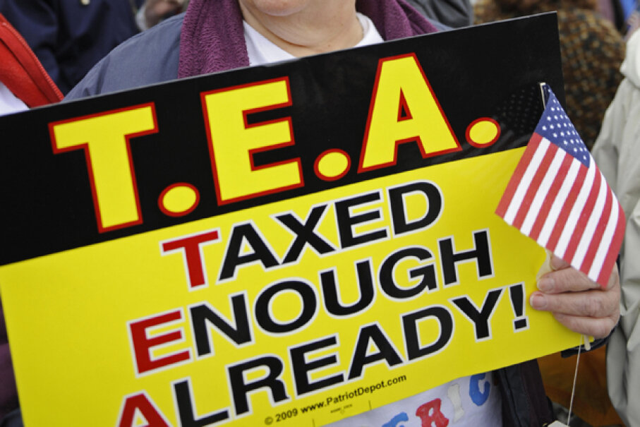 This Tea Party supporter demonstrates against paying more taxes. EMMANUEL DUNAND/AFP/Getty Images