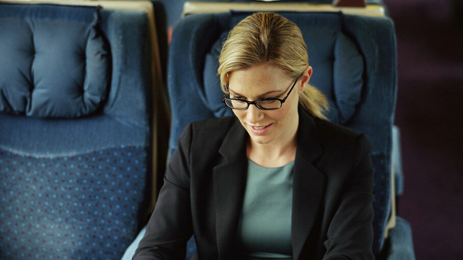 woman on train with laptop