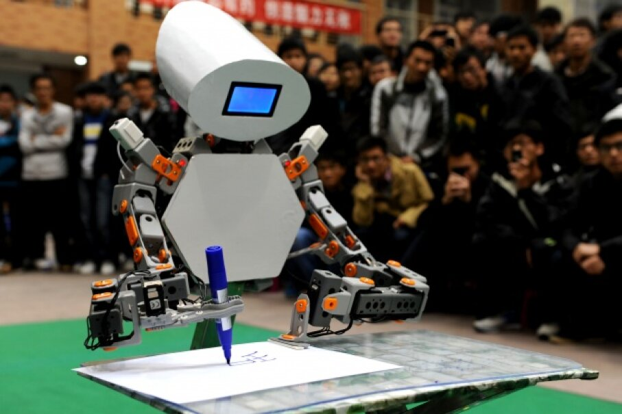 A robot shows its writing skills during a contest of intelligent robots created by college students at China's Anhui University of Science and Technology on Nov. 16, 2012. © Chen Bin/Xinhua Press/Corbis