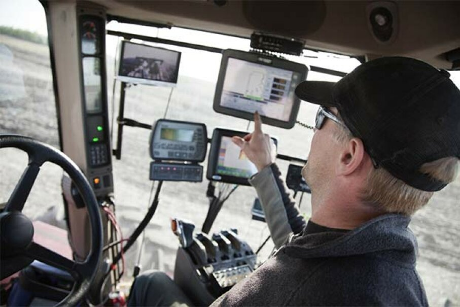 This farmer monitors several things via GPS and other high-tech tools in his tractor. LivingImages/Getty Images