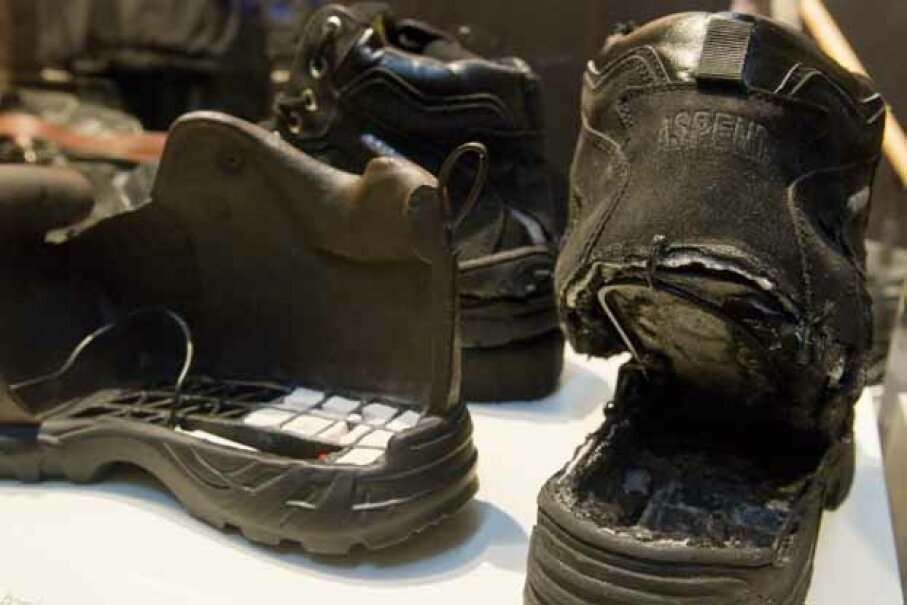 The shoes used in Richard Reid's failed attempt to blow up an airplane (R) are displayed with an FBI model of the shoe filled with explosives as part of an exhibit marking the 10th anniversary of the 9/11 attacks, at the Newseum in Washington, D.C. SAUL LOEB/AFP/Getty Images