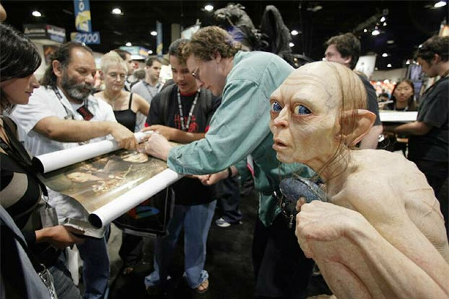 'Lord of the Rings' special effects artist Richard Taylor signs autographs for fans at Comic Con in 2003. You can bet the rotoscope on that film was done by someone else. © Reuters/CORBIS