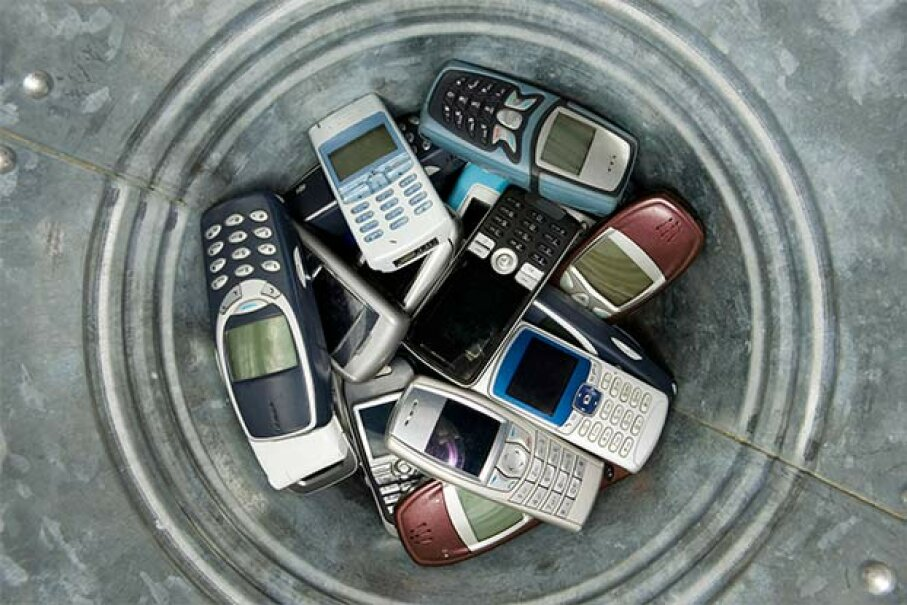 Old cell phones can be recycled and given to soldiers or people in need. Lisa Quarfoth/Hemera/Thinkstock
