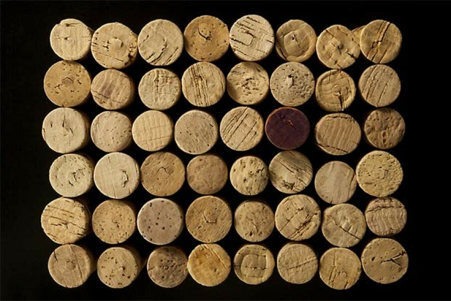 Wine corks can be glued together to make a bulletin board. dantemaisto/iStock/Thinkstock
