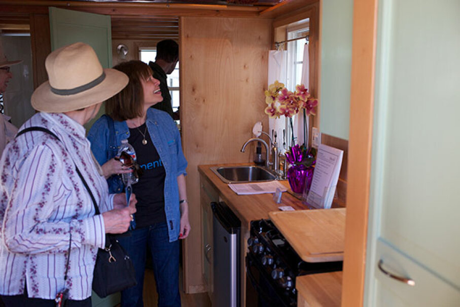 Visitors check out a tiny house interior at the Maker Faire. Jon Callas Used Under Creative Commons CC By 2.0 License
