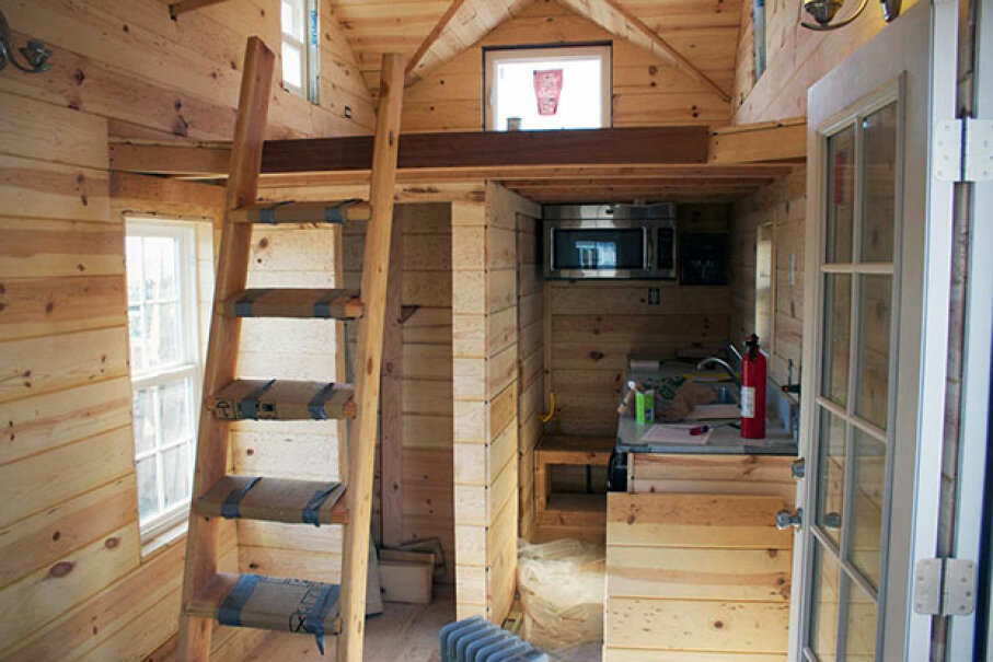 This tiny house interior shows a ladder without rails going up to the sleeping loft. Some say this is hazardous. Tomas Quinones Used Under Creative Commons CC By -SA 2.0 License