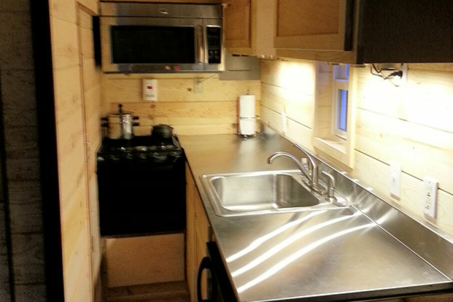 As you can see, the kitchen space is very cramped in tiny houses. Tomas Quinones Used Under Creative Commons CC By -SA 2.0 License