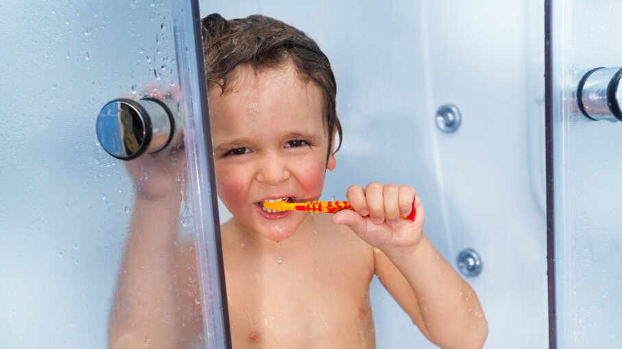 kid in shower with toothbrush