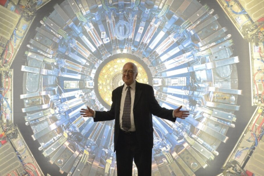 Peter Higgs, the British scientist responsible for starting all of this (Higgs) boson business, poses in front of a photo of the Atlas detector in London on Nov. 12, 2013. © Toby Melville/Reuters/Corbis