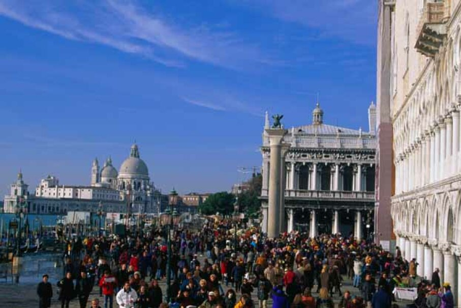 Piazza San Marcos (St. Mark's Square) in Venice: hundreds of years, hundreds of tourists and hundreds of pigeons. Juliet Coombe/Lonely Planet Images/Getty Images