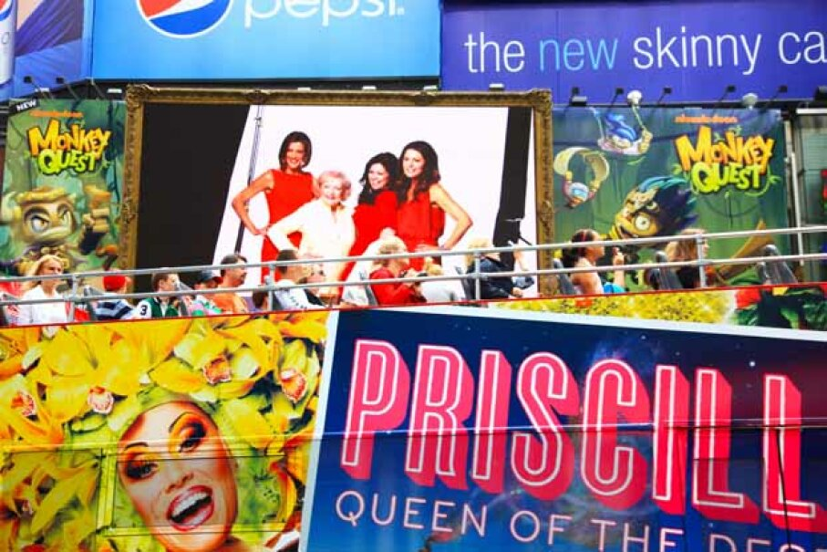 Visitors take a bus tour through the billboards of Times Square. Maremagnum/The Image Bank/Getty Images