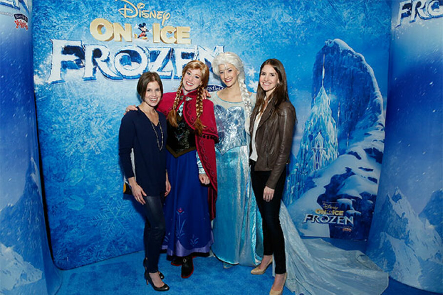 "Producers of the Disney on Ice show ""Frozen"" Nicole Feld (left) and Alana Feld (far right) pose with Princess Anna and Queen Elsa in 2014. Cindy Ord/Getty Images for FELD Entertainment"