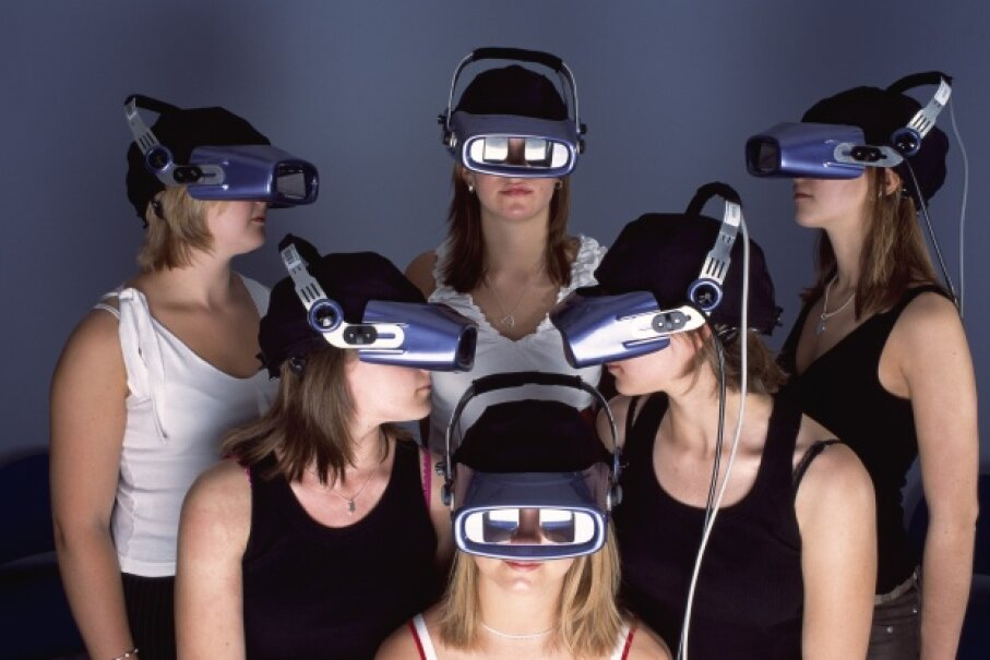 Experiments! A critical part of the scientific method. These young women participate in an experiment that's designed to monitor their brainwaves while watching TV commercials. © David Levenson/Corbis