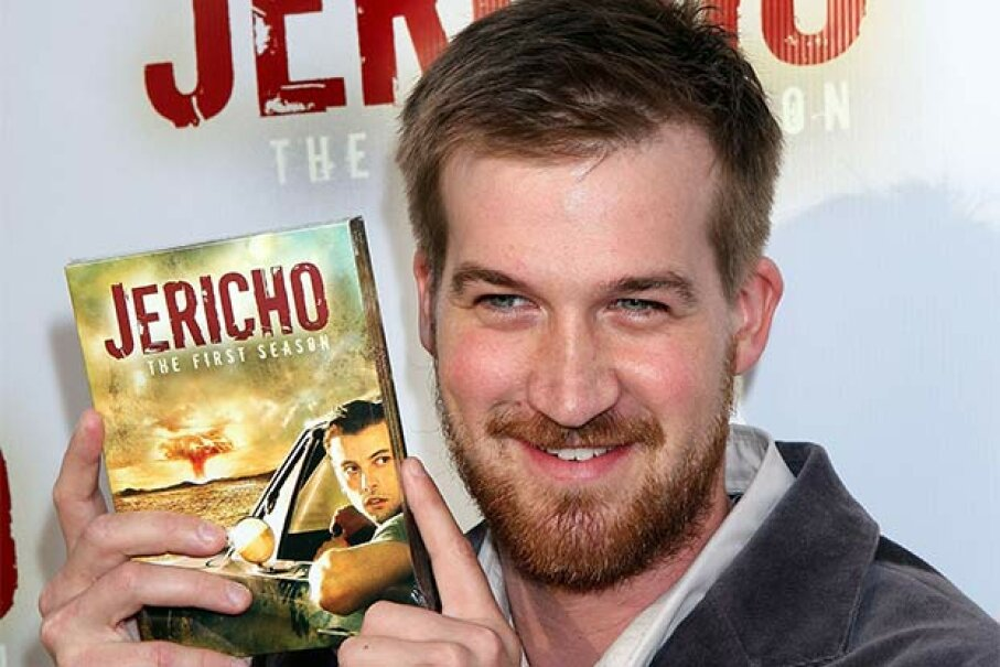 'Jericho' star Kenneth Mitchell poses with a copy of the first season DVD. U.S. government officials ordered the program canceled because of the second season storylines. Just kidding. Ryan Miller/Getty Images