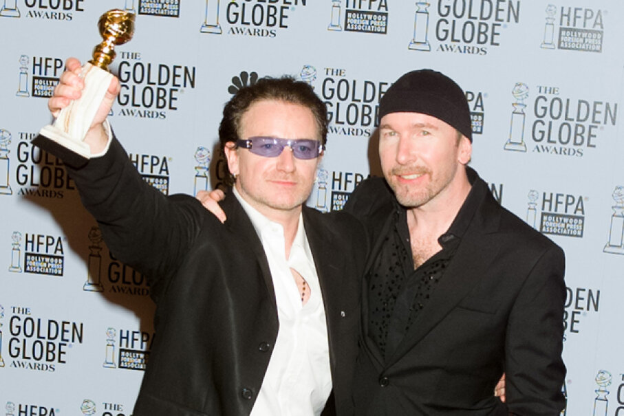 U2's Bono, left, and The Edge following their acceptance speech at the 60th Annual Golden Globe Awards on Jan. 19, 2003. NBC/NBCU Photo Bank/Getty Images