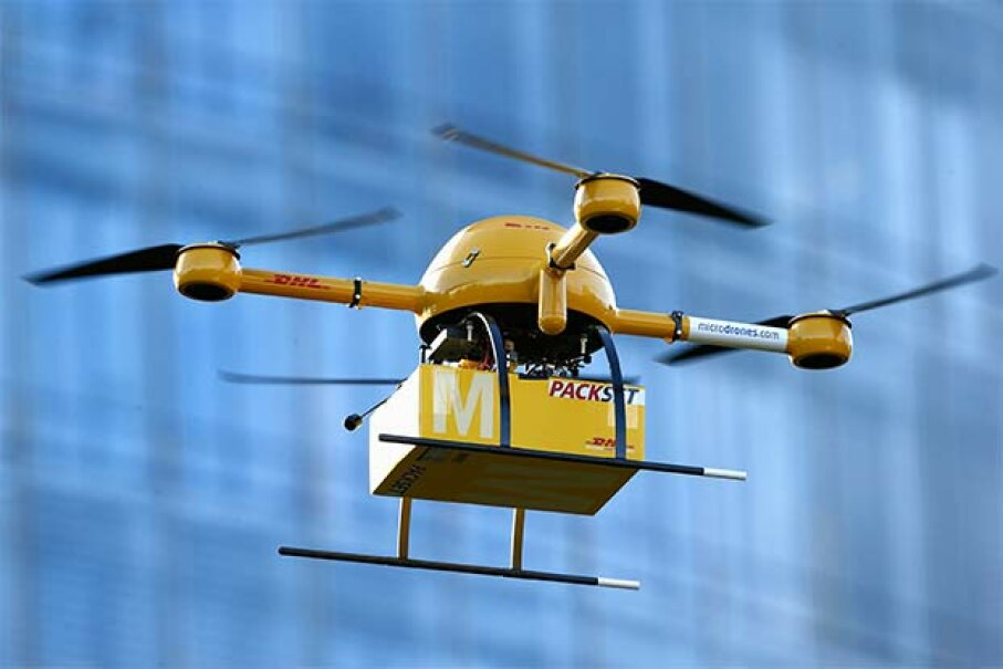 A quadcopter drone arrives with a small delivery at DHL headquarters in Berlin. The company was testing the delivery of medicine from a pharmacy in Bonn. Andreas Rentz/Getty Images