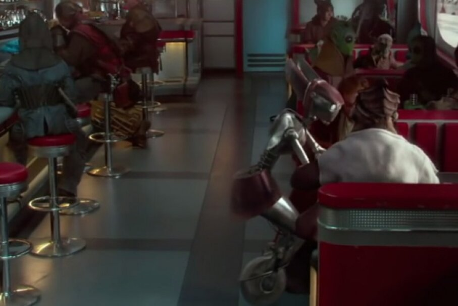 Diner full of customers, and Dexter sits there chatting with Obi-Wan while FLO does all the work. Screen capture by HowStuffWorks