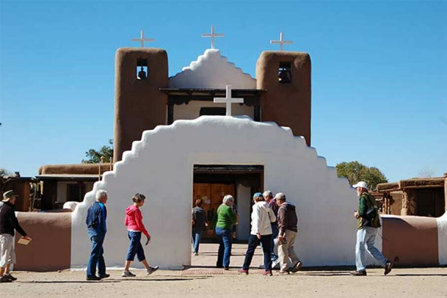 Visitors enter St. Jerome Church in Taos Pueblo, New Mexico. Taos is home to a bizarre noise known as the Taos Hum. Robert Alexander/Getty Images