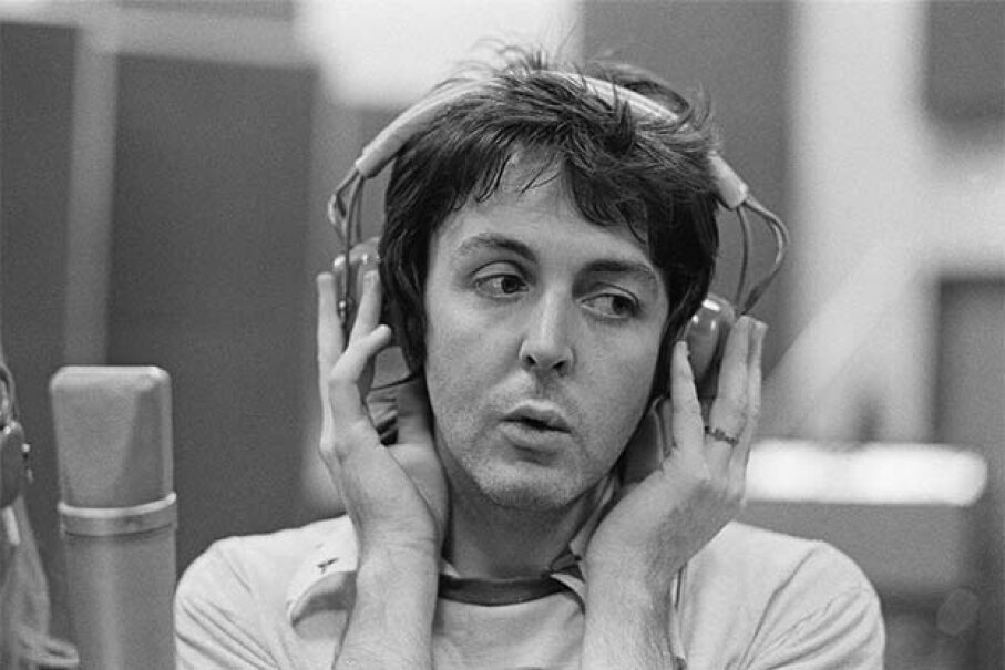 Paul McCartney listens to a playback in a recording studio in 1973. Back in the late '60s, fans thought he had died and been secretly replaced with a lookalike. They listened to Beatles recordings backwards for clues. Michael Putland/Getty Images