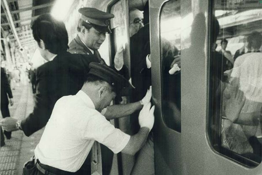 An oshiya (pusher) is needed to cram passengers into a commuter train during rush hour in crowded Tokyo, as seen in this 1987 photo. Andrew Stawicki/Toronto Star via Getty Images