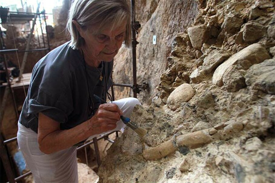 French paleontologist Marie-Antoinette De Lumley works at the archaeological prehistoric site of Caune de l'Arago in Tautavel, France. Paleoscatlogists are paleontologists who specialize in the world of fossilized poop. RAYMOND ROIG/AFP/Getty Images