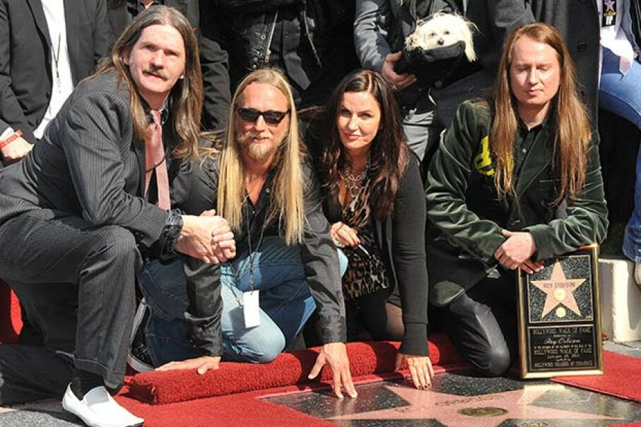Roy Orbison's widow Barbara and sons pose at his installation into the Hollywood Walk of Fame in 2010. After more than 20 years, the family still hasn't gotten a headstone for the late singer. © Frank Trapper/Corbis