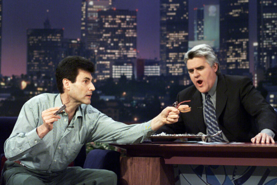 """Uri Geller returned to the """"Tonight Show"""" stage in 2000 to amaze Jay Leno, 27 years after former host Johnny Carson asked another magician to debunk Geller's abilities. Paul Drinkwater/NBC/Getty Images"""
