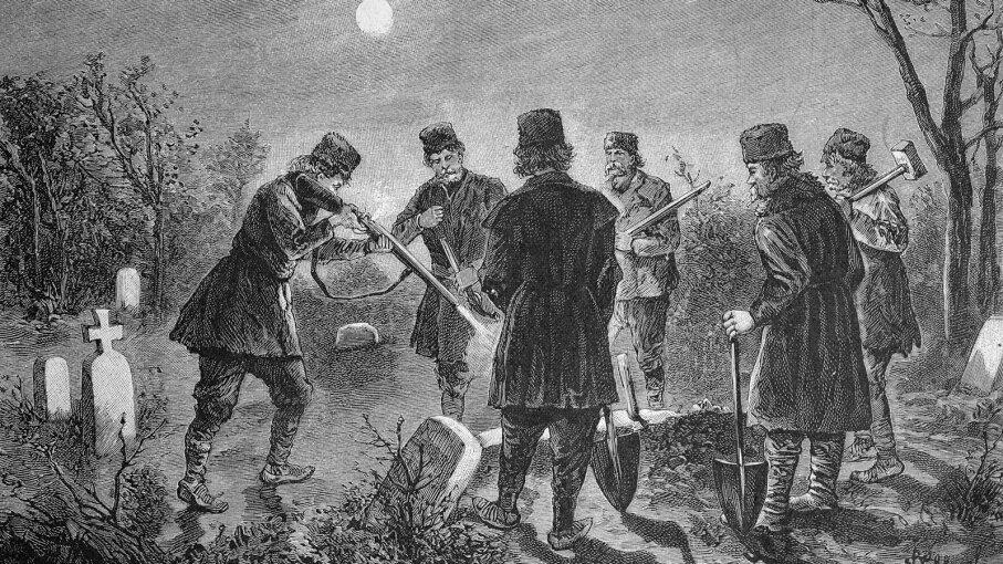 men get rid of a vampire in a graveyard in Romania